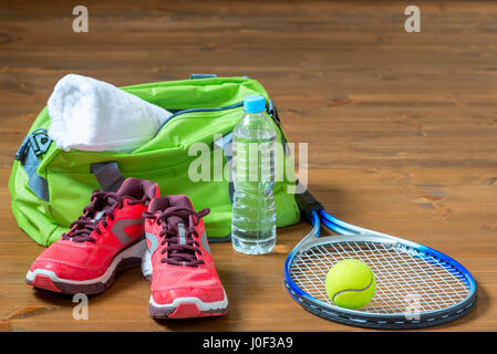 Set of sports facilities for playing tennis on the floor - Stock Photo