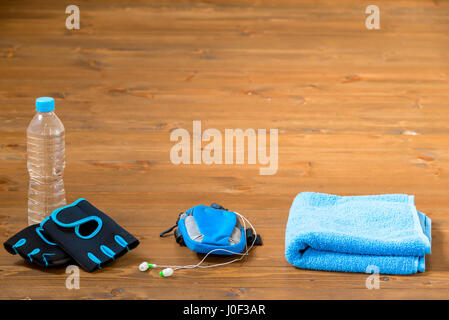 Objects for sports for men on the wooden floor - Stock Photo