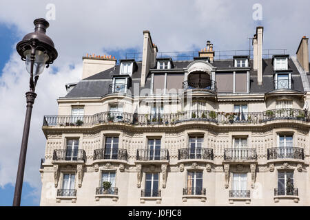 Paris, France - a typical facade of an apartment building with balconies - Stock Photo