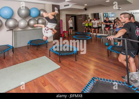 Otwock, Poland - Semptember  10, 2016: A sporty boy somersaulting backwards - Stock Photo