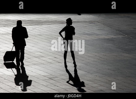 silhouette of a beautiful woman waiting outside airport - Stock Photo