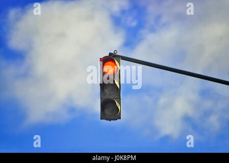 Traffic light on a cloudy sky background - Stock Photo