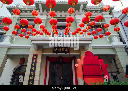 George Town, Malaysia - March 24, 2016: Yap Kongsi clan house decorated with chinese red lanterns, Armenian Street, - Stock Photo