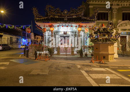 George Town, Malaysia - March 24, 2016: Dusk view of the Choo Chay Keong Temple adjoined to Yap Kongsi clan house, - Stock Photo