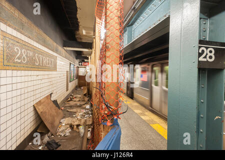 Part of the platform of the 28th Street station on the IRT Number 1 line subway in New York is seen partially cordoned - Stock Photo