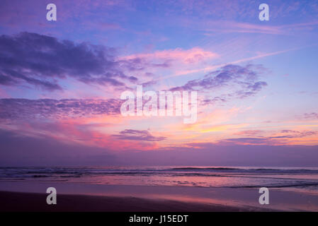 Atlantic ocean sunset with pink and purple sky, Lacanau France - Stock Photo