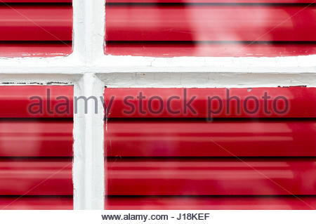 Looking at a window with bright red horizontal blinds inside, Hamble le Rice, Hampshire - Stock Photo