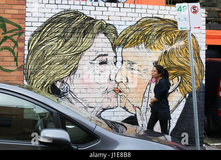 Melbourne Australia. 21st April 2017. A mural in Melbourne showing  Donald Trump kissing  his presidential rival - Stock Photo