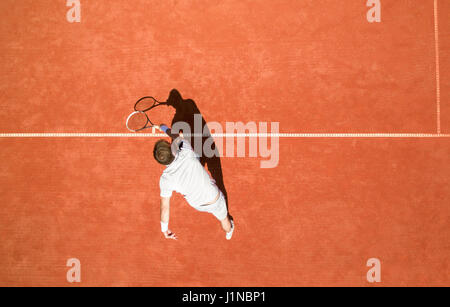 Top view of male tennis player in action - Stock Photo