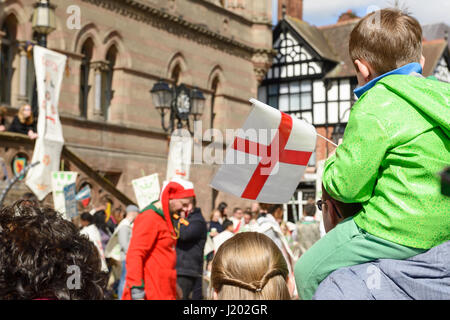 Chester, UK. 23rd April 2017. A boy with a flag watching the St George's day medieval street theatre performance - Stock Photo