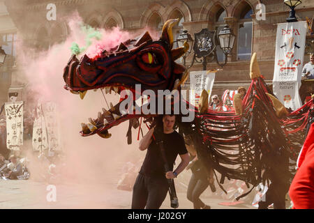Chester, UK. 23rd April 2017. A smoke breathing dragon makes an entrance as part of the St George's day medieval - Stock Photo
