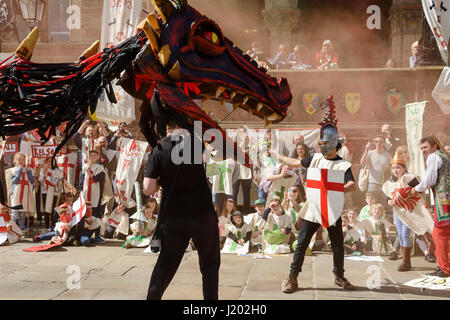 Chester, UK. 23rd April 2017. A smoke breathing dragon fights with St George as part of the St George's day medieval - Stock Photo