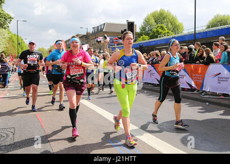 London, UK. 23rd April, 2017. Runners take part in the London Marathon Credit: Dinendra Haria/Alamy Live News - Stock Photo