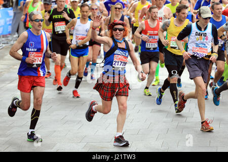 London, UK. 23rd April, 2017. Participants take part in the Virgin London Marathon 2017. Pictured passing Cutty - Stock Photo