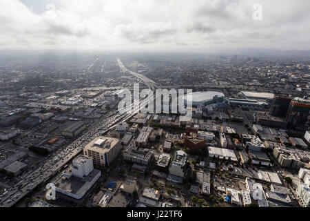 Aerial view of Los Angeles 10 and 110 freeways with afternoon clouds in Southern California. - Stock Photo