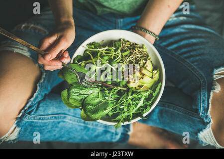 Vegetarian breakfast with spinach, arugula, avocado, seeds and sprouts - Stock Photo