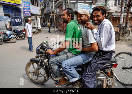 Amritsar, India, september 4, 2010: Young men on a motorcykle, smiling, India. - Stock Photo
