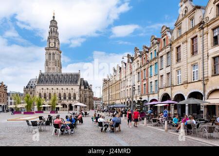 Pavement cafes on La Place des Héros looking towards the Town Hall, Arras, Pas de Calais, France - Stock Photo