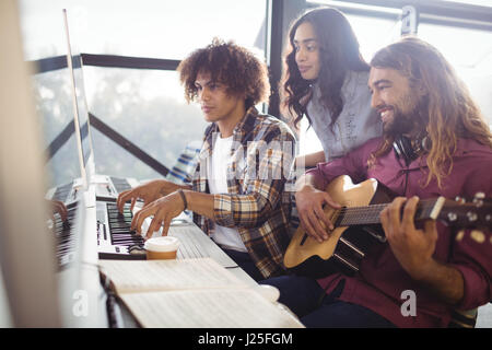 Two sound engineers working together in the studio - Stock Photo