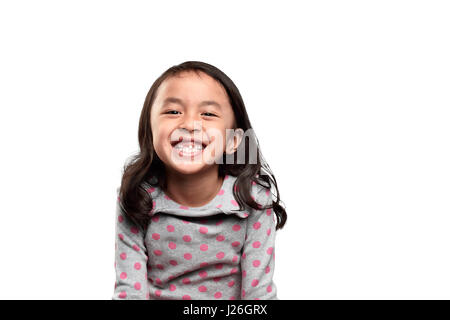 Smiling asian kid showing her missing tooth isolated over white background - Stock Photo