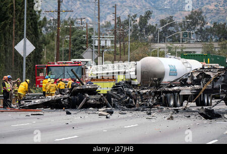Los Angeles, USA. 25th Apr, 2017. Firefighters work at the scene after a multi-vehicle crashed on a freeway near - Stock Photo