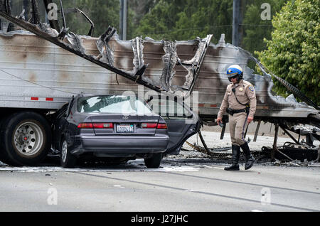 Los Angeles, USA. 25th Apr, 2017. A policeman works at the scene after a multi-vehicle crashed on a freeway near - Stock Photo