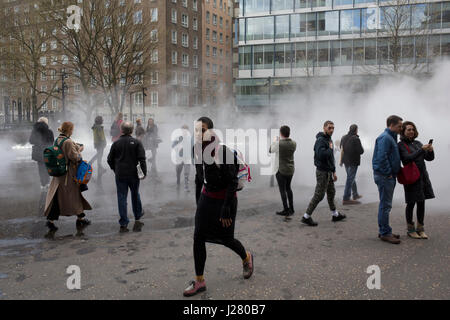 Japanese artist Fujiko Nakaya's cloud of mist, fog sculpture outside Tate Modern Switch House as part of a new live - Stock Photo
