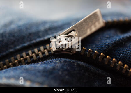 close up of denim item or jeans zipper - Stock Photo