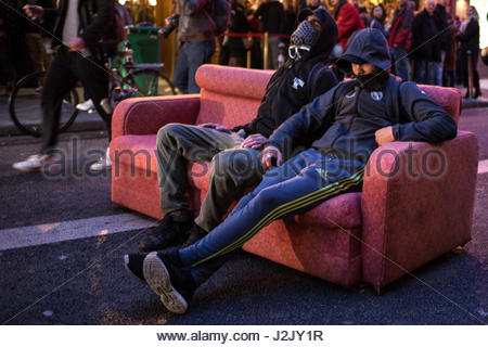 Paris, France. 28th Apr, 2017. Two protesters sit on a couch as hundreds take to the streets in Paris on April 28, - Stock Photo