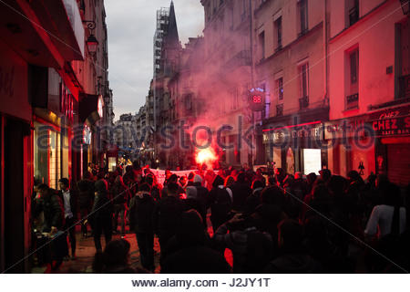 Paris, France. 28th Apr, 2017. Protesters use flare as hundreds take to the streets in Paris on April 28, 2017 to - Stock Photo
