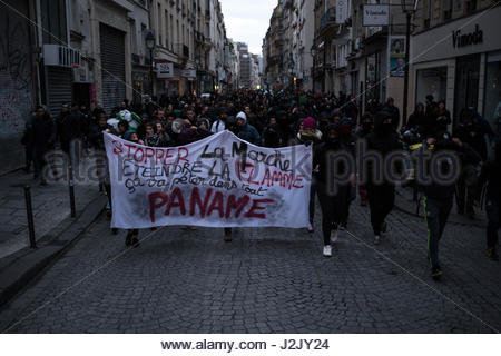 Paris, France. 28th Apr, 2017. Protesters march behind a banner as hundreds take to the streets in Paris on April - Stock Photo