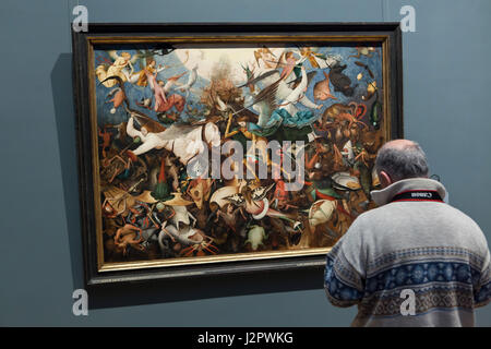 Visitor in front of the painting 'The Fall of the Rebel Angels' by Dutch Renaissance painter Pieter Bruegel the - Stock Photo