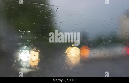 abstract blurred rain background view through wet car window stock photo royalty free image. Black Bedroom Furniture Sets. Home Design Ideas