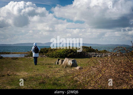 DAGSHOG, SWEDEN - APRIL 27, 2017. Female hiker  by the coast, on windy day. - Stock Photo
