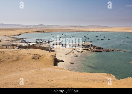 Village in sandy desert close to the cliffs. Perfect place to see tropical desert, wide cliffs and coloful beaches - Stock Photo