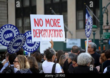 New York, USA. 1st May, 2017. People holding signs at a May Day rally in New York City. Credit: Christopher Penler/Alamy - Stock Photo