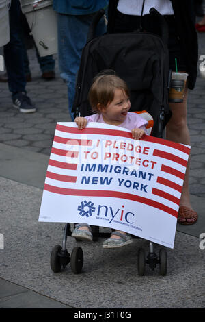 New York, USA. 1st May, 2017. Young child holding a sign at a May Day rally in New York City. Credit: Christopher - Stock Photo