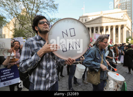 New York, USA. 1st May, 2017. Demonstrators take part in the 'Rise Up New York' rally at Foley Square in New York, - Stock Photo
