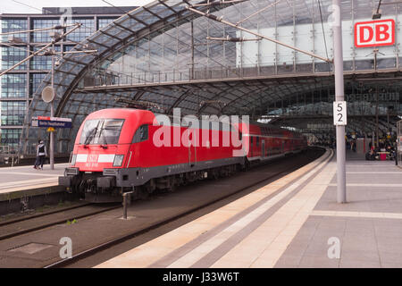 BERLIN, APRIL 24TH: An RE (Regional Express) regional train in Berlin Hauptbahnhof (german for Central Train Station) - Stock Photo