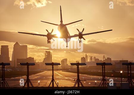 Passenger airplane landing at London City Airport - Stock Photo