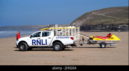 Newquay, Cornwall, UK - April 7 2017: RNLI Lifeguard with truck and jetski on a Cornish surfing beach at Newquay - Stock Photo