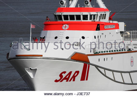 The DGzRS rescue cruiser HERMANN MARWEDE inbound for the port of Cuxhaven - Stock Photo