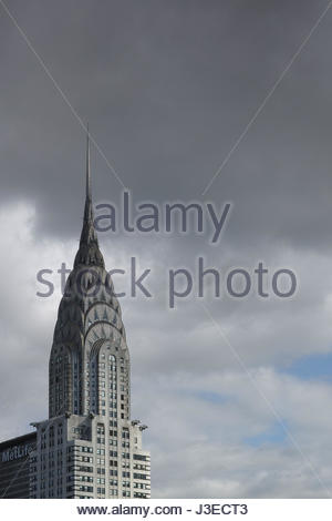 Top of Chrysler building with dark clouds behind it - May 3, 2017, 40th Street, New York City, NY, USA - Stock Photo