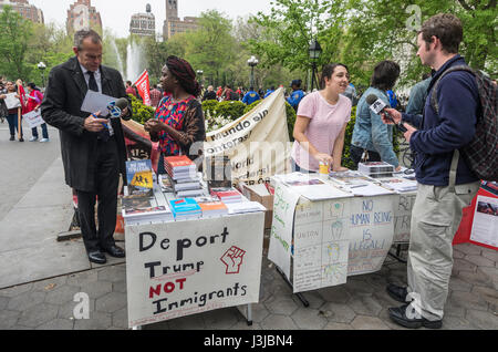 New York, NY USA - 1 May 2017 - Members of the Socialist Alternative tabeling at a May Day rally, speak with the - Stock Photo