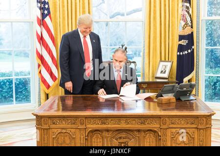 U.S. President Donald Trump looks on as EPA Administrator Scott Pruitt adds his signature to the Waters of the United - Stock Photo