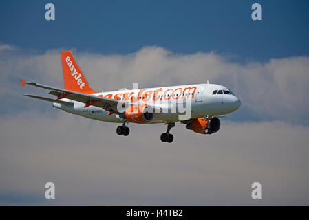 Easyjet commercial passenger Airbus A 320-214 aircraft in its unmistakeable company orange livery - Stock Photo