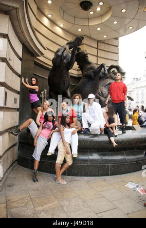 Mixed group of young dancers posing at Leicester Square, London, UK - Stock Photo