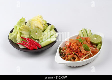 Spicy and sour mixed herb salad with pork skin and pork rind  is popularThai cuisine served - Stock Photo