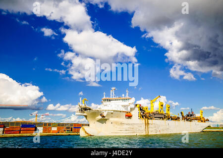 Transport ship in the port of Antwerp in Belgium - Stock Photo