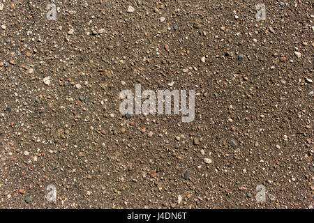 Close up detailed view of coarse asphalt road coating background or texture - Stock Photo